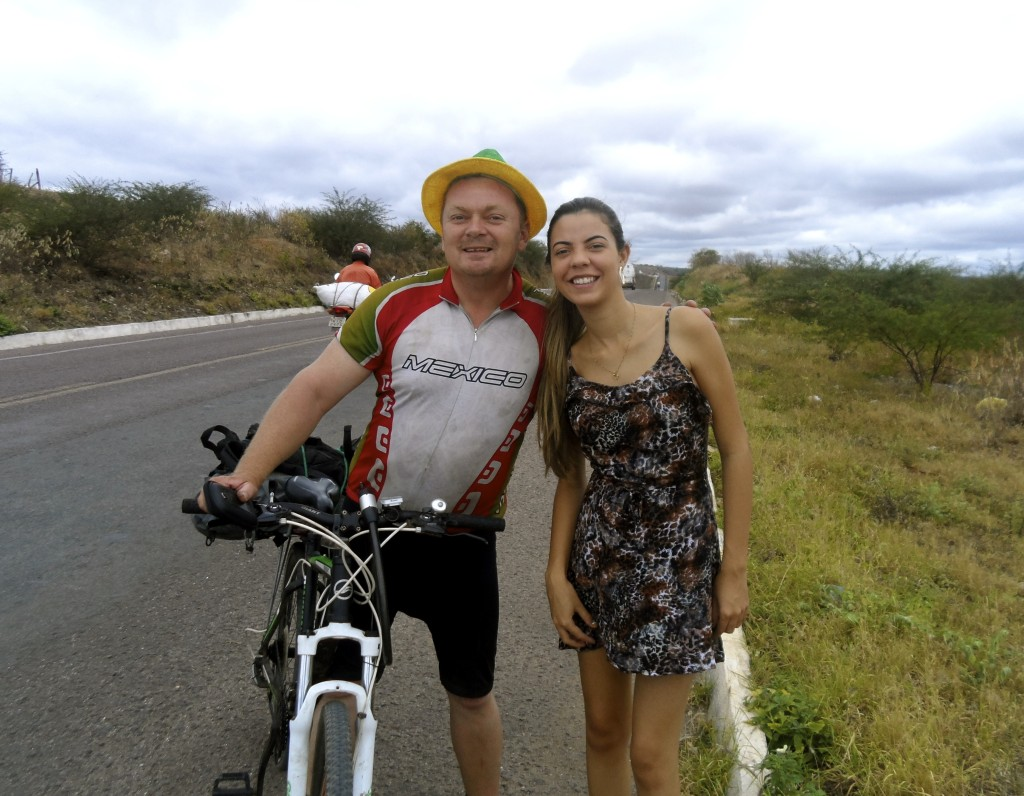 Posing for photos with a local girl in Pernambuco.