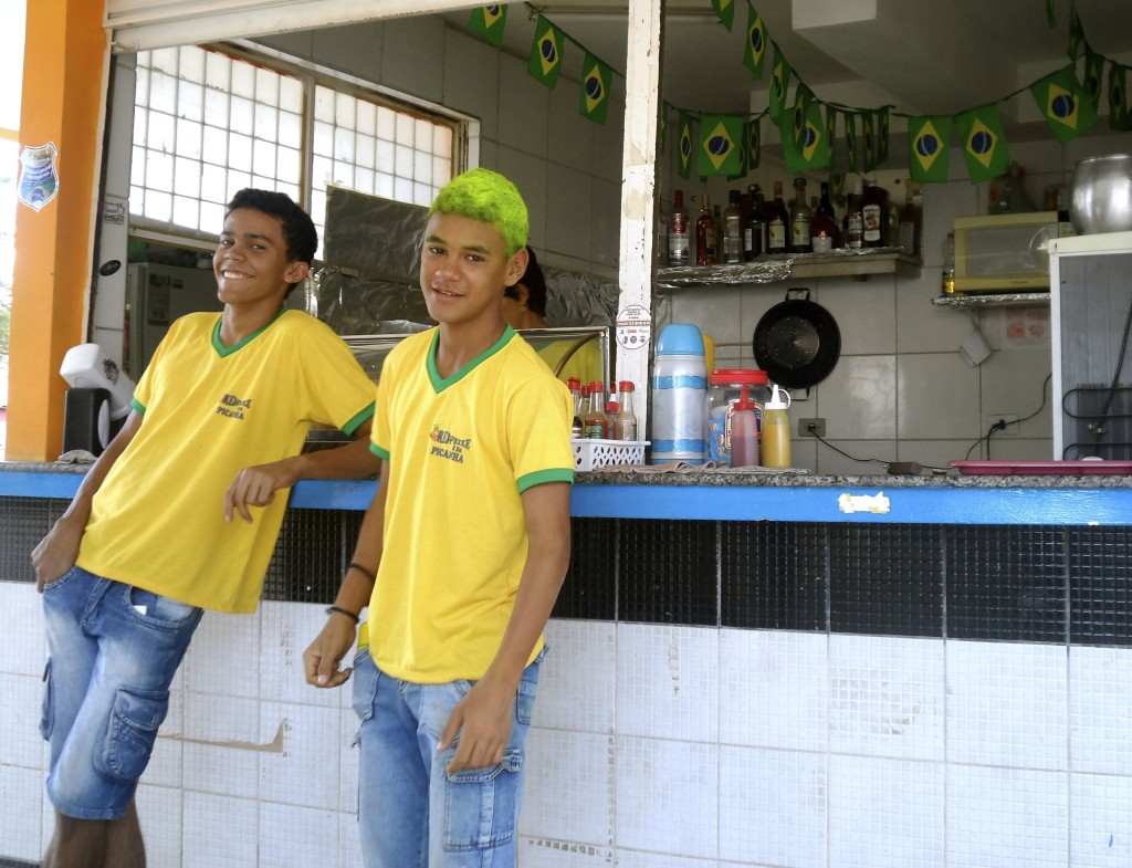 Young waiter with world cup colors in his hair.