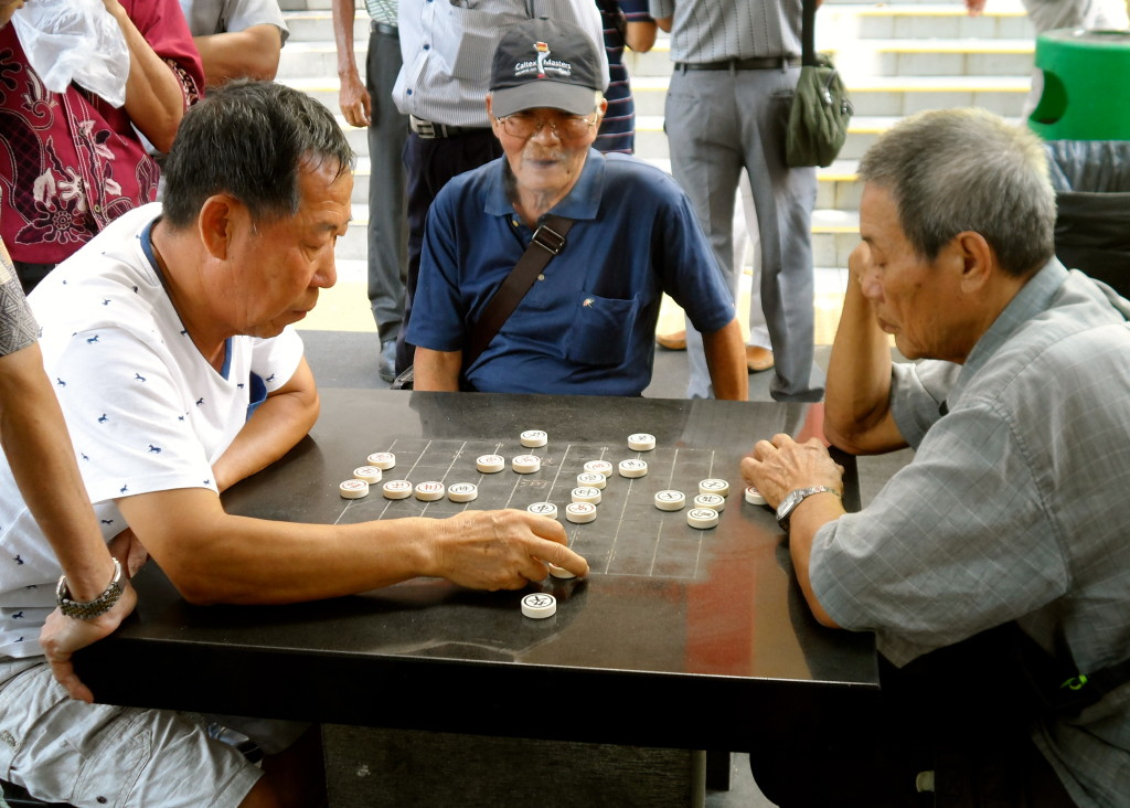 Old men playing chess in Singapore.