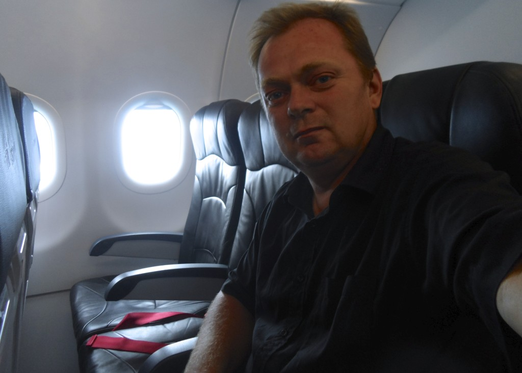 Me taking a selfie onboard Air Asia.