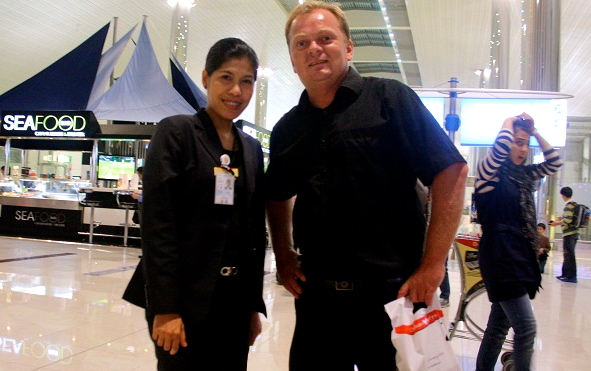 Meeting a friend during a layover in Dubai airport.