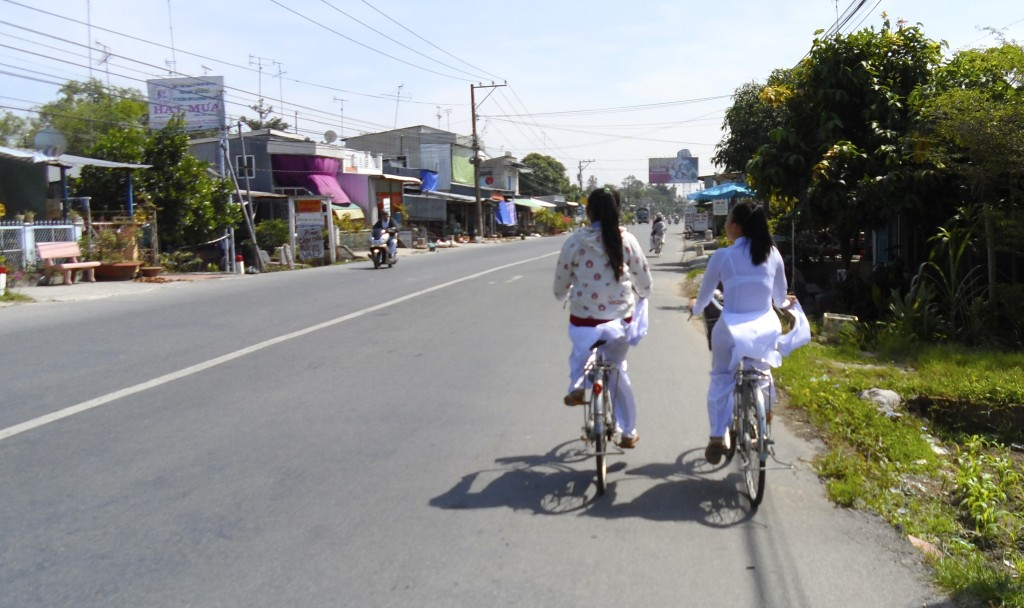 Vietnamese school girls cycling.