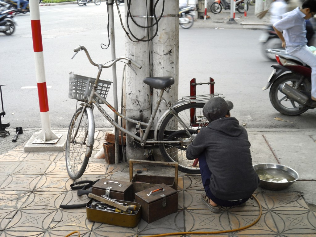 Roadside bicycle mechanic in Vietnam.