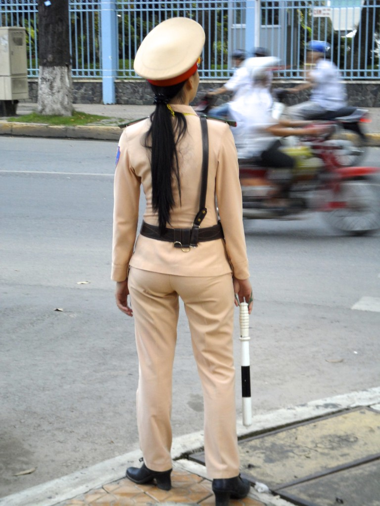 Beautiful vietnamese traffic police girl.