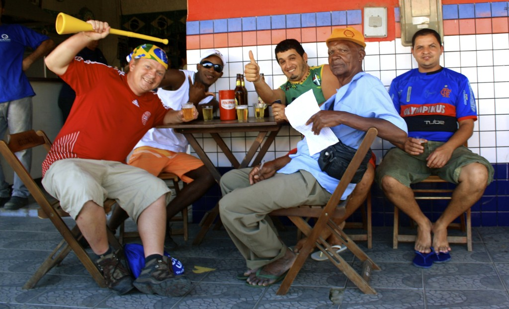 With fellow football fans in rural Brazil