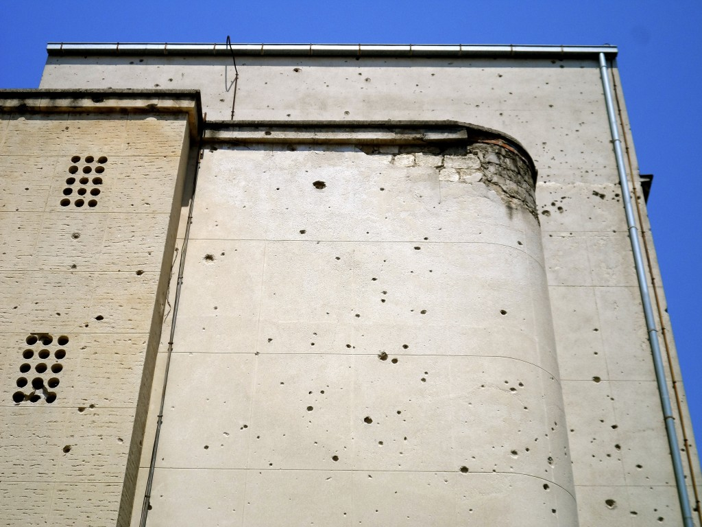 Bullet holes in a building in East Mostar.