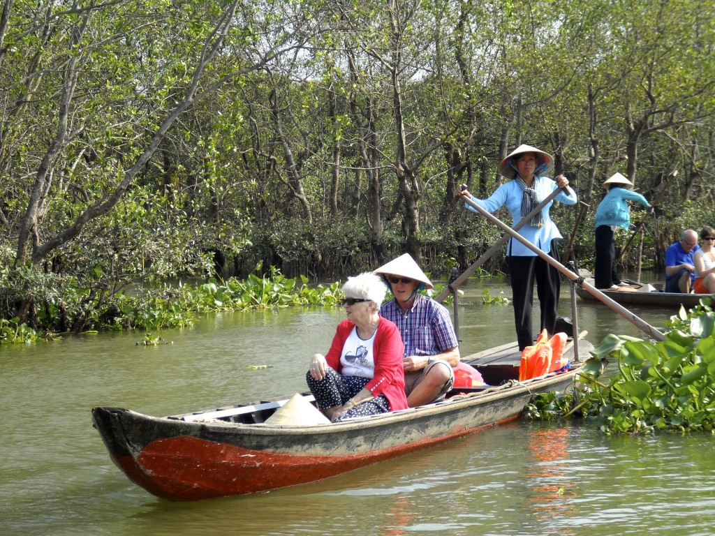 Happy tourists in the Mekong Delta.