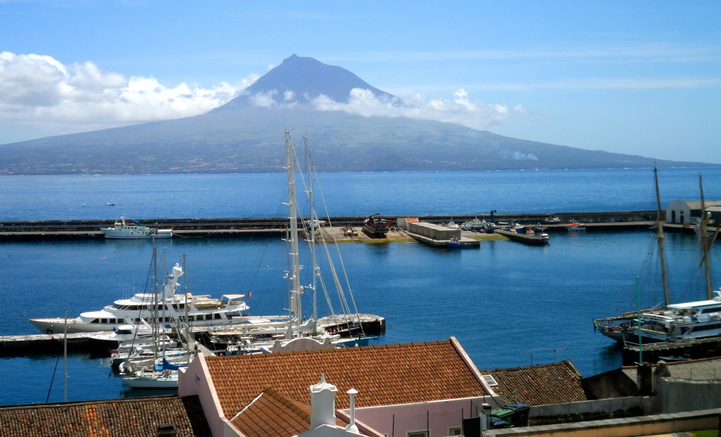 The harbor of Horta, with the island Pico in the background.