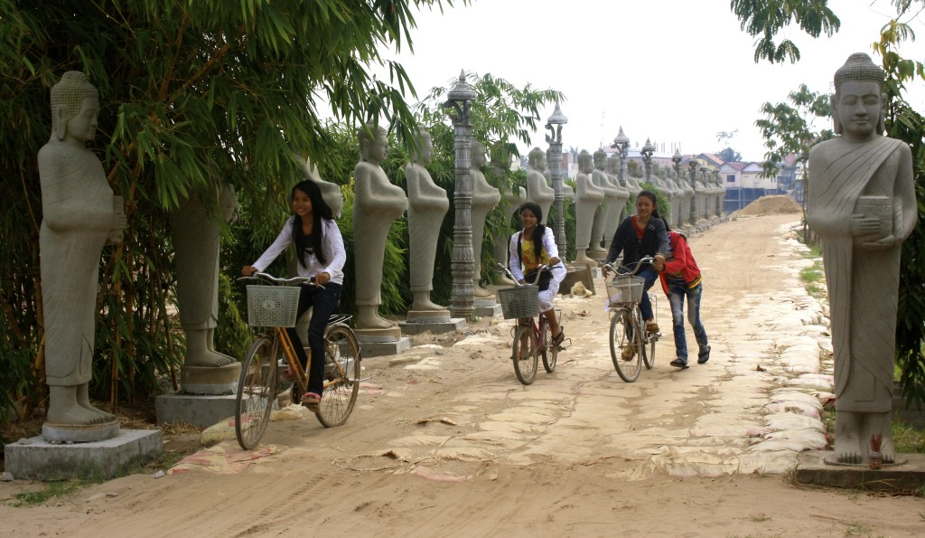 Cambodian girls cycling home from school.