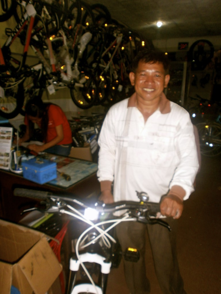The friendly bike shop owner in Siem Reap.