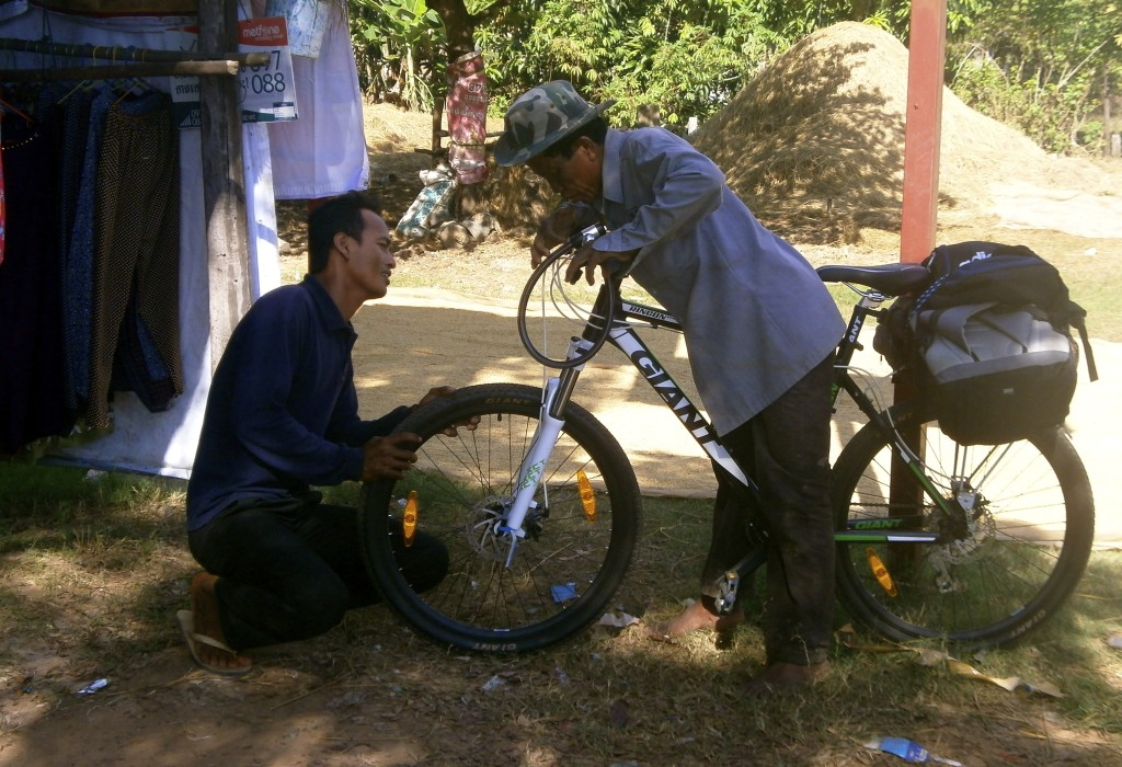 Cambodian guys checking out my bike.