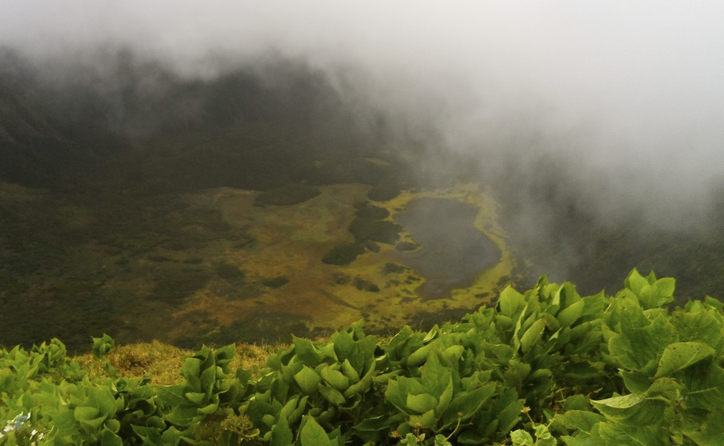 Walking on a crater rim on the Azores.
