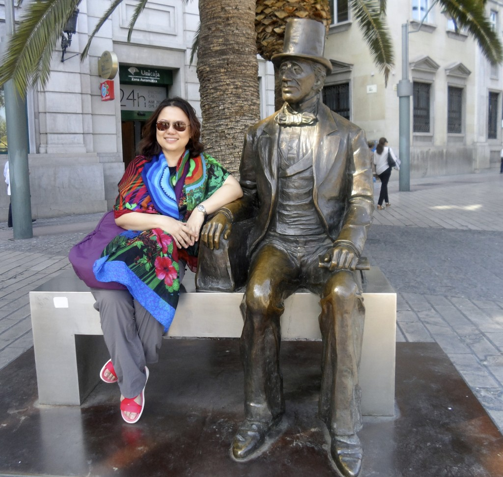 Attractive women keep Hans Christian Andersen company on his bench in Malaga.