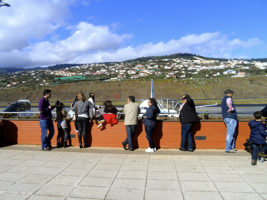 People at the observation deck at Madeira Airport.