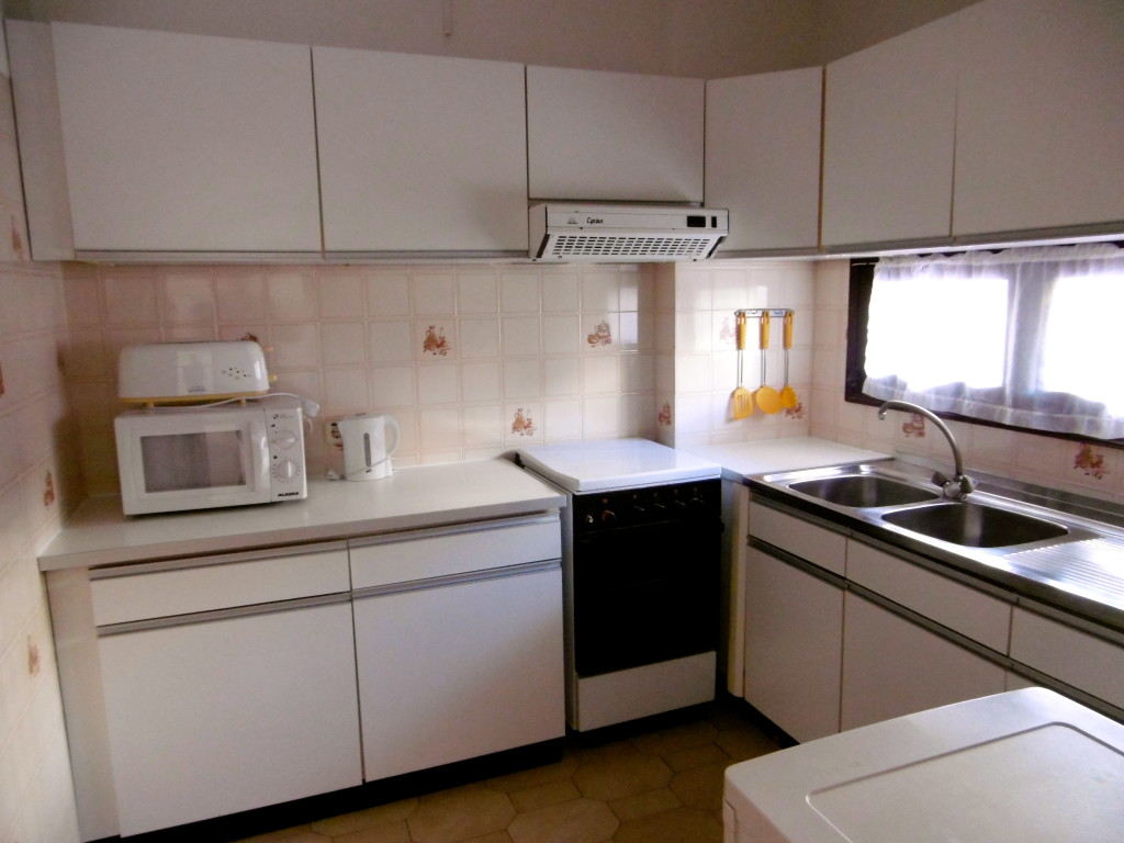 Nice big kitchen at Apartamentos Rainha D. Leonor
