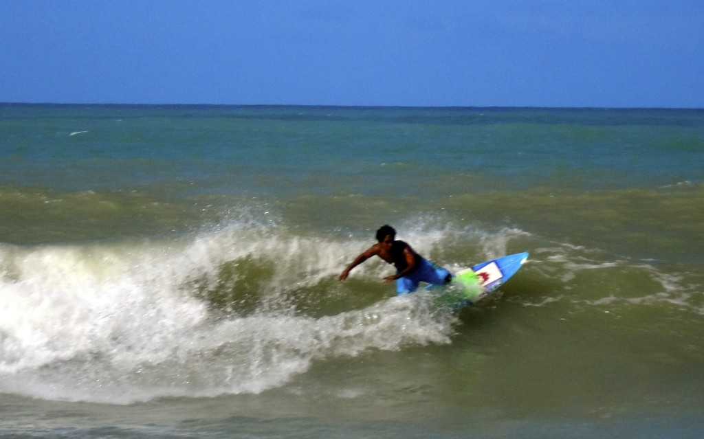 Surfing the brazilian waves.