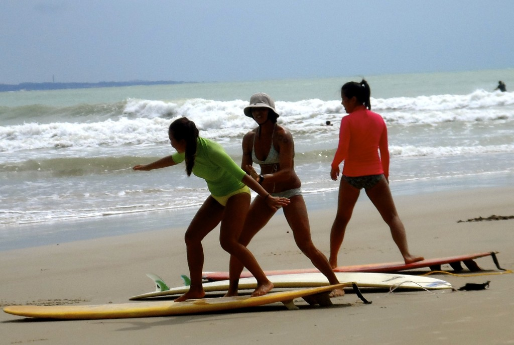 Surfer girls on Praia da Pipa.