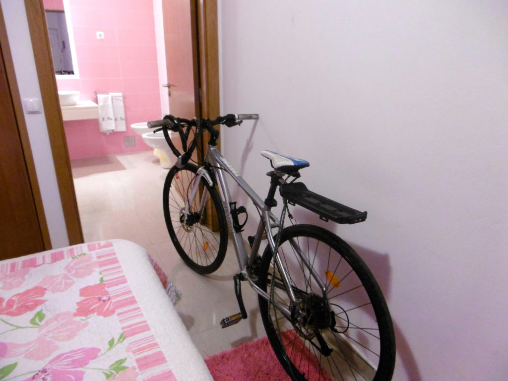 My broken bicycle in my hotel room.