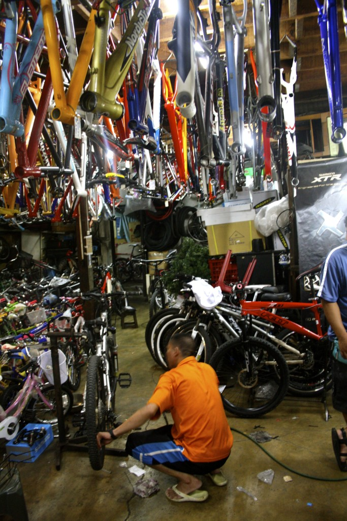 Getting some repair done at a bicycle shop in Manila.