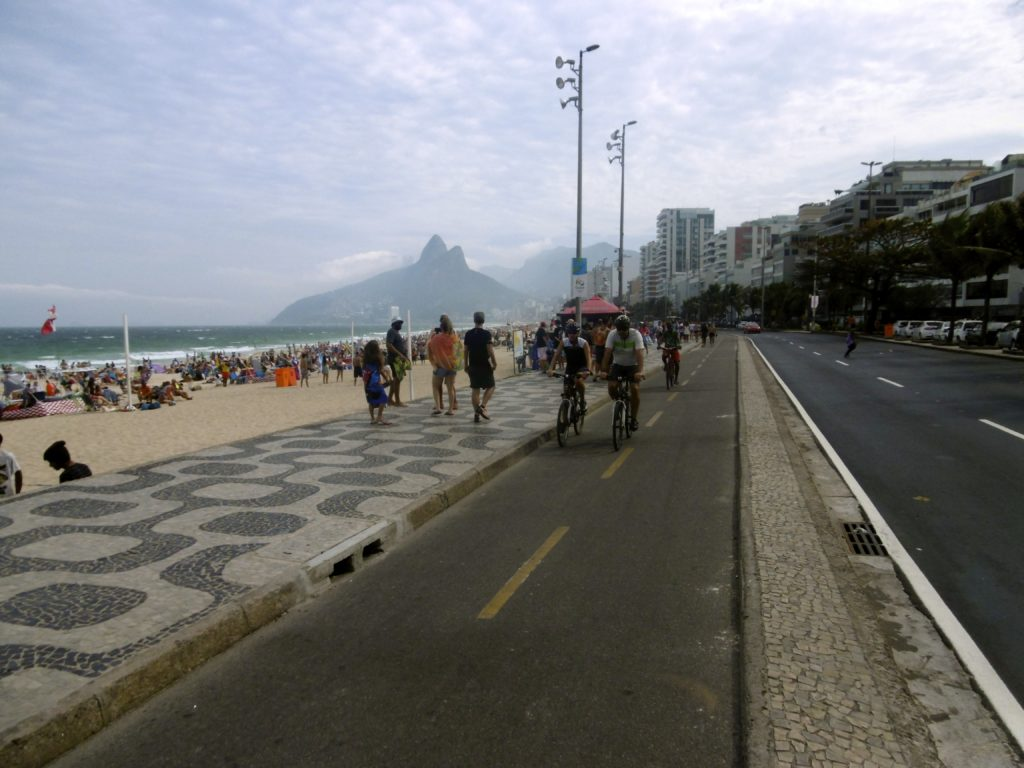 Cycling down the Ipanema beach promenade.