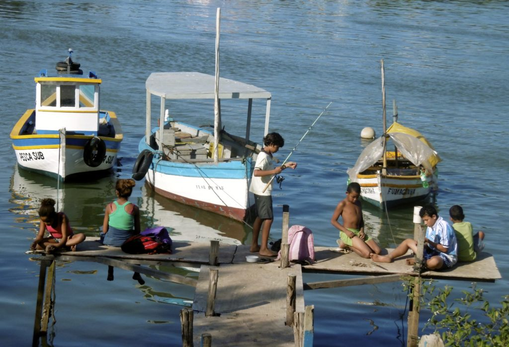 Brazilian children fishing.