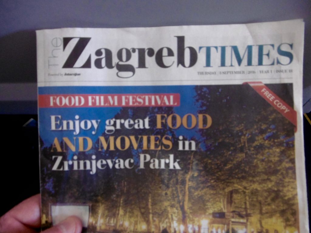 Reading Zagreb Times on the flight.