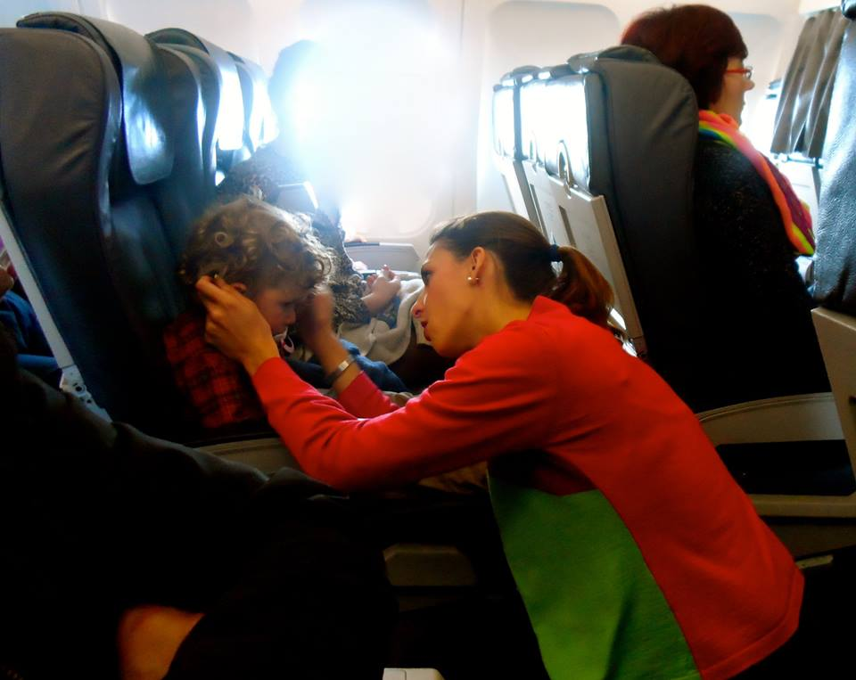 Flight attendant from SATA comforting a passenger.