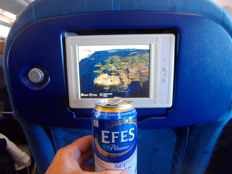 Fly, drink beer and have an empty seat next to you.