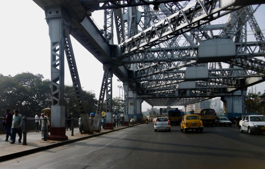 Driving across Howrah bridge.