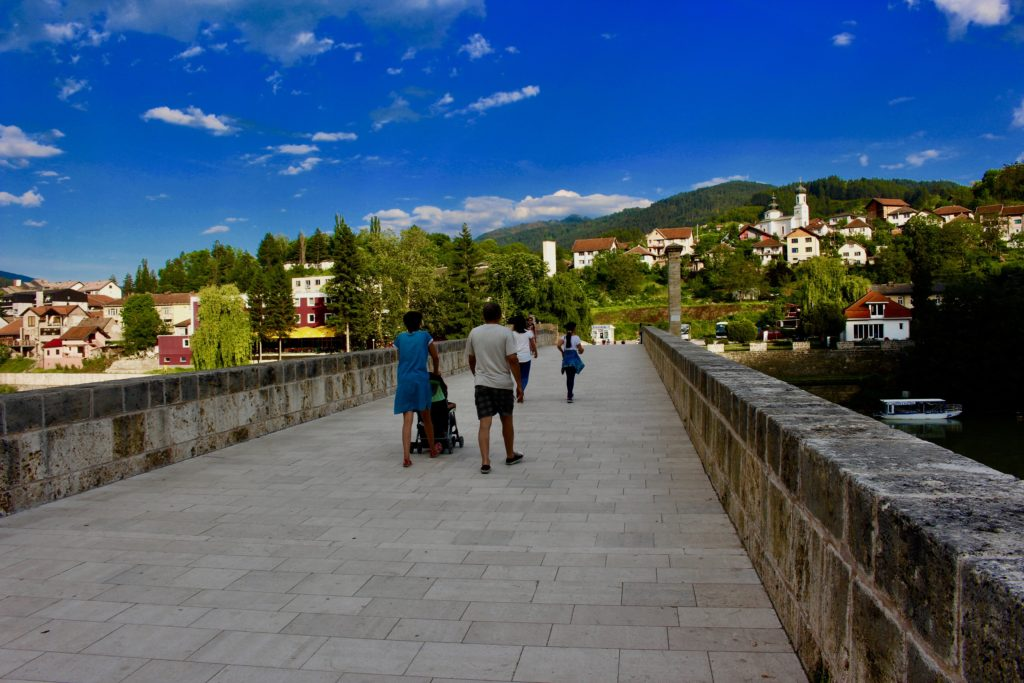 Local Visegrad inhabitants walking across the bridge.
