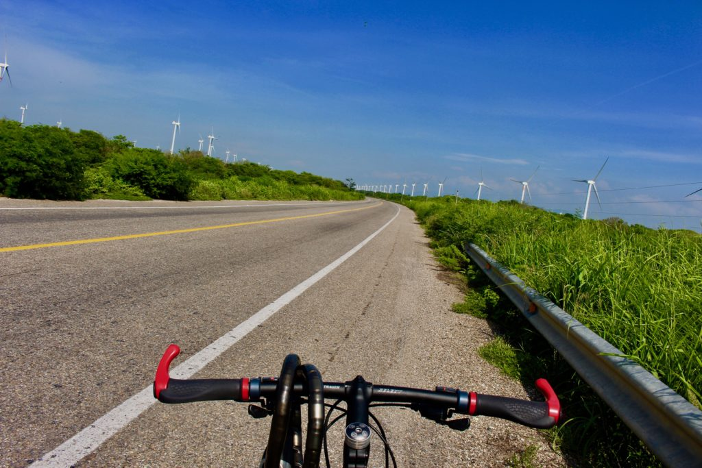 Cycling past windfarms at La Ventosa.