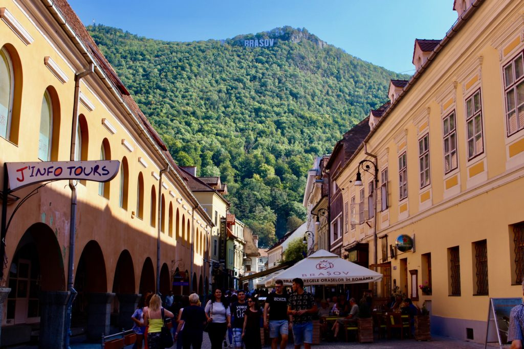 Brasov is a beautiful town with a Hollywood sign on top.