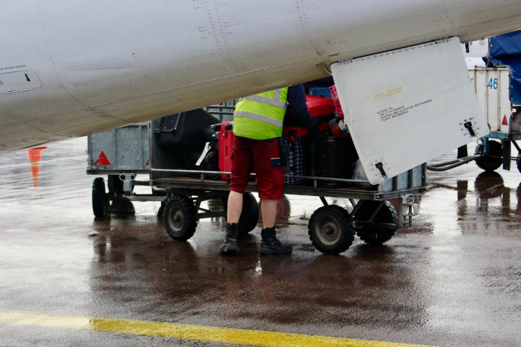 Helsinki baggage handlers wearing shorts in December.