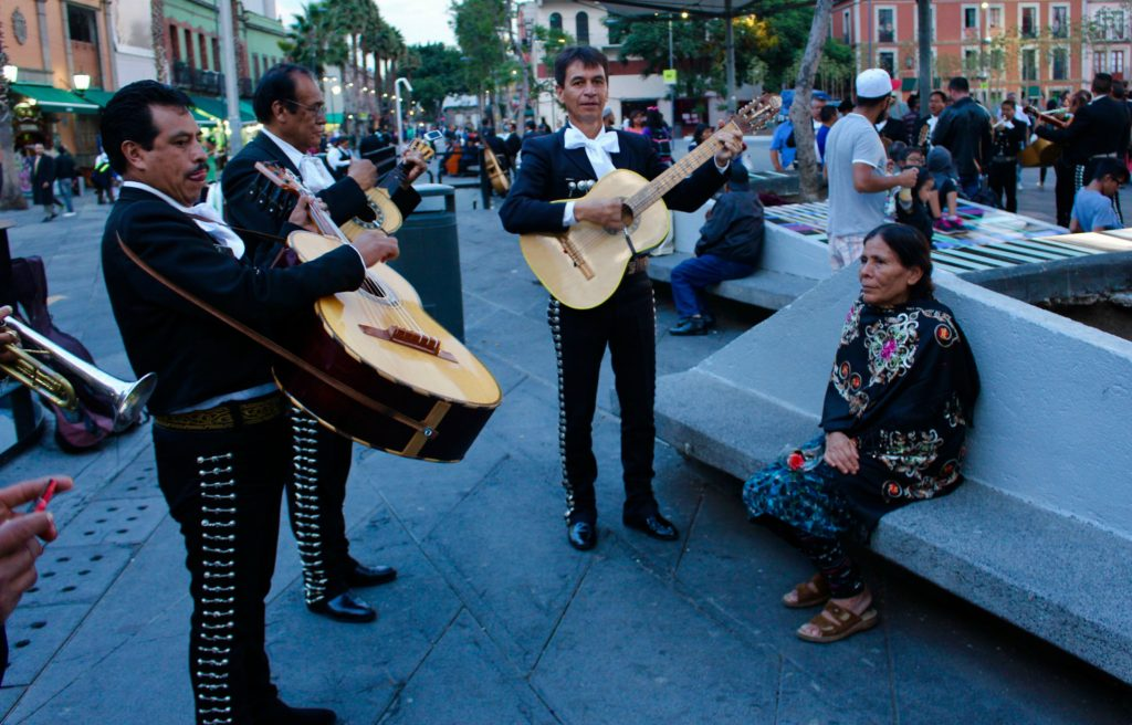 Mariachi band serenading for an elderly lady.