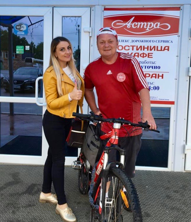 With my bike in Russia, while posting with one of the locals.