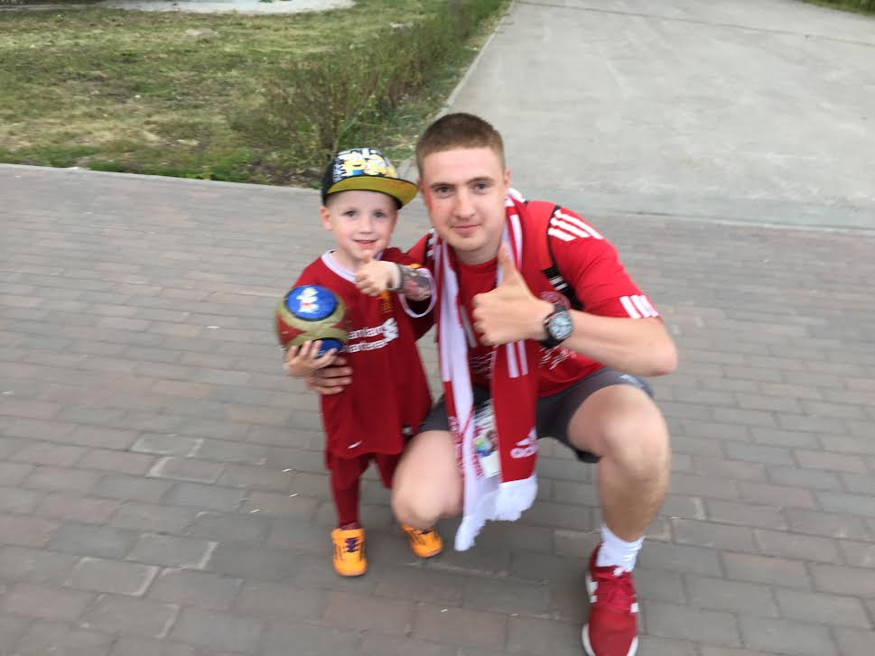 Meeting with a Russian father and his son after a game.
