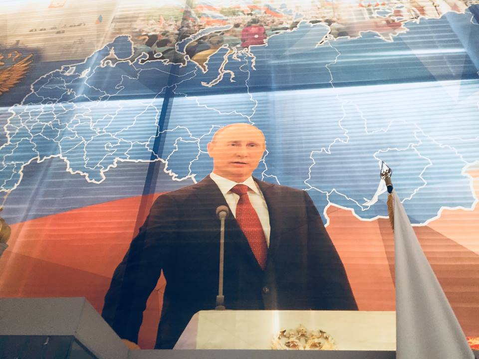 Vladimir Putin has a large portrait at the Lenin memorial.