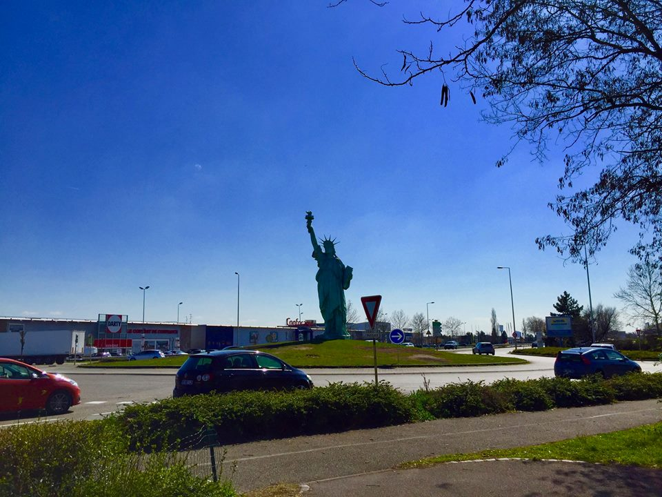 The statue of Liberty in Colmar is standing in a roundabout.